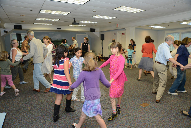 Pat Campbell, back/center, led guests through a series of community dance steps during a special program at C.H. Booth Library on July 22.   (Bobowick photo)