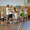 "Pretending to be zoo animals, children race forward in a game of ""Feed The Animals,"" Tuesday, July 24, one of several team-building games played during the week of July 23 by boys and girls in grades kindergarten through sixth attending the Faith at Newtown Vacation Bible School program in the Edmond Town Hall gymnasium. Pastor Timothy Kuhn said that 20 youth from the Ruskin, Fla., First Baptist Church assisted at the camp, held each day from 1 to 3 pm, staying at the homes of congregation members. Using the theme of ""Big Apple Adventure,"" participants formed teams with names connected to New York City  and competed in a variety of games each day to accumulate the most points. Points were earned not only through winning games, but by team behavior, knowledge of Bible verses, and success in team-building exercises. 	   (Crevier photo)"