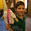 At the end of the first session of Newtown Continuing Education's SMART (Summer Music and Arts) camp program, a SMART Showcase was held on Friday, July 13, to demonstrate projects and new talents the students learned during the multiple course offerings. Ethan Paley, photographed, held up a puppet he created the Puppet Making program. The second session of SMART concluded on Friday, July 27, with another SMART Showcase.   (Hallabeck photo)