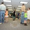 Pat Campbell, center, led guests through a series of community dance steps during a special program at C.H. Booth Library on July 22.   (Bobowick photo)
