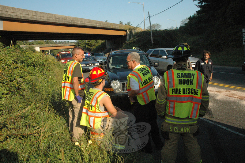 Sandy Hook Volunteer Fire & Rescue Company members, Newtown Volunteer Ambulance Corps, and town police responded to a two-vehicle accident that occurred on Berkshire Road (Route 34) near the Interstate 84 overpass at about 8:22 am on September 14. Police said motorist Barbara Ahearn, 51, of Woodbury, who was driving a 2005 Ford Escape SUV southward on Berkshire Road, stopped for traffic conditions, after which a southbound 2005 Jeep Liberty SUV driven by Lillie Pesola, 60, of Danbury struck the rear end of the Ford. There were no injuries. The firefighters isolated the automotive fluids that were spilled in the accident. Police said they issued Pesola a written warning for failure to drive a reasonable distance apart.   (Gorosko photo)