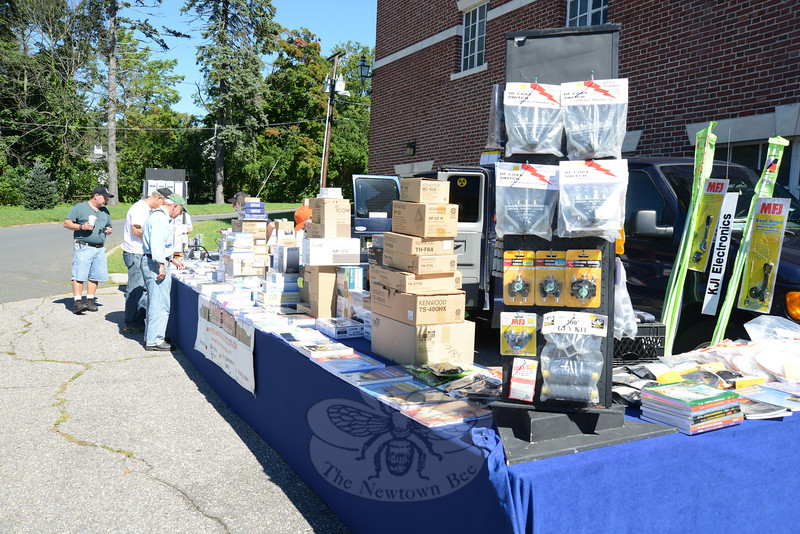 Amateur radio enthusiasts browsed at a table of commercial radio goods during the 2012 CARA Hamfest.  (Bobowick photo)