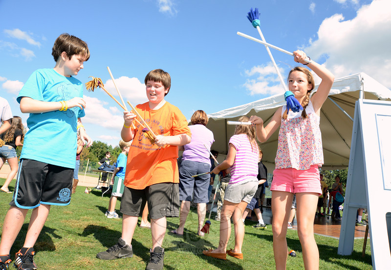 "Charli Condon, right, and friends Connor Munro, left, and AJ Salaris, center, practiced juggling with flower sticks at The Newtown Juggling & Circus Arts Club location.   (Bobowick photo)<br /> <br /> PLEASE NOTE: A separate gallery with all photos that made up the slideshow that accompanied our final recap of the arts festival can be found here:<br />  <a href=""http://photos.newtownbee.com/Journalism/Special-Events/2012-Newtown-Arts-Festival/25555573_hjNtHq#!i=2107532147&k=Zfn5Dh9"">http://photos.newtownbee.com/Journalism/Special-Events/2012-Newtown-Arts-Festival/25555573_hjNtHq#!i=2107532147&k=Zfn5Dh9</a>"