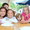 Carl Bianco peers from behind his sister Grace, left, and from the left, Amber McCulloch, Reinna Bianco, and Madison McCulloch during the Botsford Fire Rescue Company Summer Bash. (Bobowick photo)
