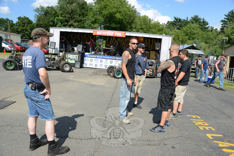 Botsford Fire company member Jay Conley faces the camera, briefly distracted from his conversation with  Patrick Keough, Mike Locorotondo, and Zak Ouellette during the Botsford Fire Rescue Company Summer Bash. (Bobowick photo)