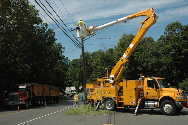 A crew from the Connecticut Light & Power Company (CL&P) responded to 51 Berkshire Road (Route 34) at the Misty Vale Deli early on the afternoon on August 21 to repair accidental damage that occurred to an electric line. Sandy Hook Fire Chief Bill Halstead said that a trailer, which was being hauled by a SUV, snagged a guy wire on a utility pole at the deli's driveway, resulting in an impact that caused a primary electric line to fall to the ground. There were no injuries. The 12:23 pm incident caused traffic to be detoured onto adjacent roads in the area. (Gorosko photo)