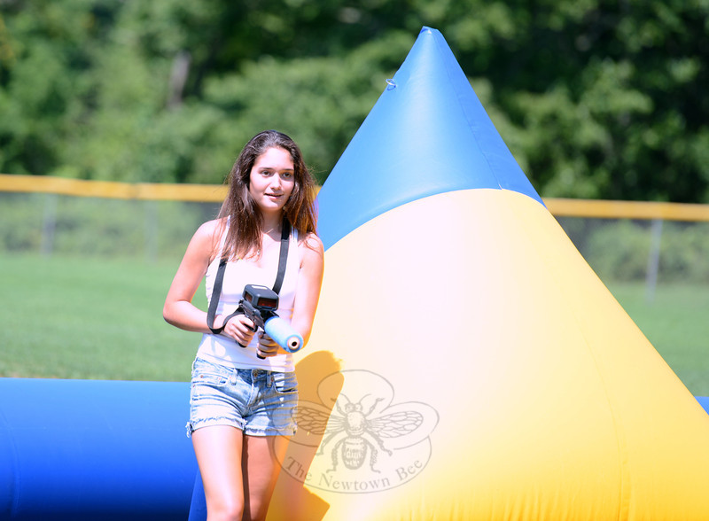Erica Hill boldly steps away from protection as she looks for her next mark on Thursday, August 16, during a morning of laser tag overseen by Parks & Recreation.  (Bobowick photo)