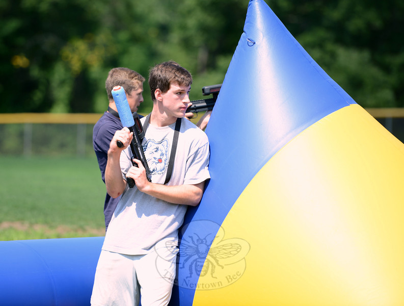 Wesley Morlock leans against the inflatable wall, waiting for a clear shot during a morning of laser tag on Thursday, August 16. (Bobowick photo)