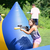Julia Diluoffo breaks her cover to shoot on Thursday, August 16, during a morning of laser tag overseen by Parks & Recreation. (Bobowick photo)