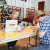 Jessica Blauvelt sells raffle tickets to musician Mark Kadan with the Nightriders band that performed during the Botsford Fire Rescue Company Summer Bash. (Bobowick photo)