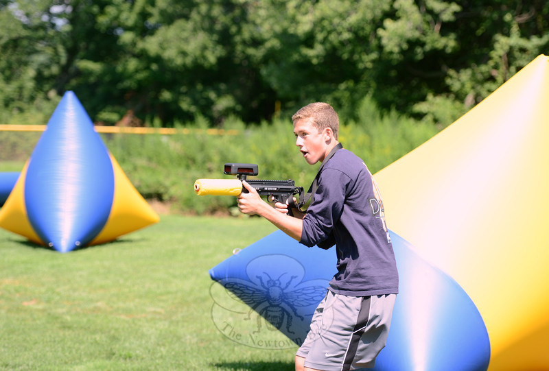 Matt Mossbarger lines up his shot on Thursday, August 16, during a morning of laser tag overseen by Parks & Recreation. (Bobowick photo)