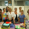 Newtown Junior Women's Club members met at the Newtown Meeting House on Thursday, August 16, to complete the club's Back-To-School Backpack Program. (Hallabeck photo)