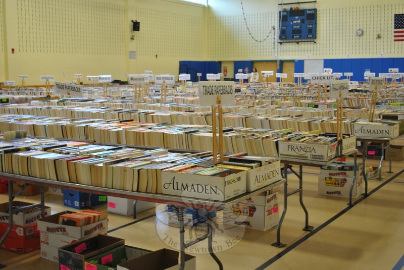"Opening day of this year's Friends of Booth Library Book Sale was Saturday, July 13.   (Crevier photo)<br /> <br /> PLEASE NOTE: Additional photos from this event, which were presented online in a slideshow, can be viewed here: <a href=""http://photos.newtownbee.com/Journalism/Special-Events/Friends-of-Booth-Library-2013/30752329_vnDzwr#!i=2658611120&k=G8h5N94"">http://photos.newtownbee.com/Journalism/Special-Events/Friends-of-Booth-Library-2013/30752329_vnDzwr#!i=2658611120&k=G8h5N94</a>"