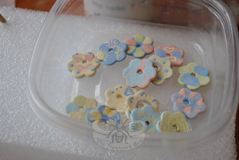 A container of Kindness Coins shows the creativity of those glazing the ceramic pieces.  (Crevier photo)