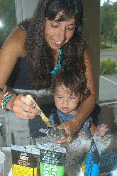 Newtown's Casey Ragan paints with her son, Jake Ragan, to help create artwork for Urgent Care of Connecticut's soon-to-be Newtown office.  (Hutchison photo)
