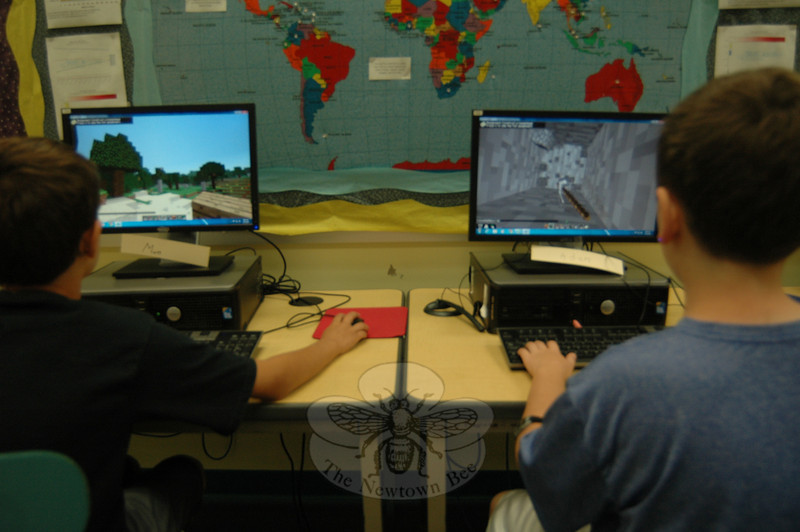 Students in Tim McGuire's Minecraft course, offered through Newtown Continuing Education, worked on mining for virtual materials on Monday, July 15.   (Hallabeck photo)