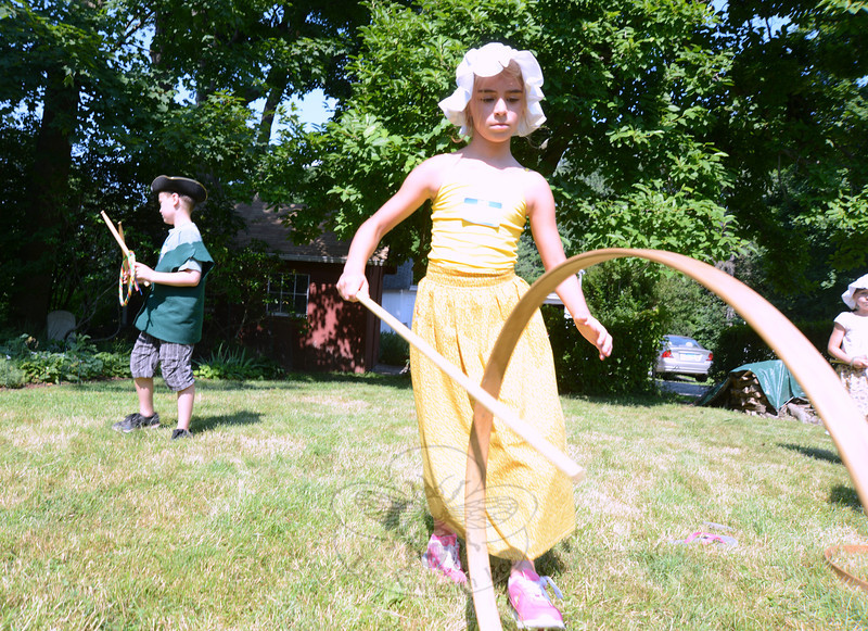 Molly Moran plays at an old-fashioned children's game of hoops at the Newtown Historical Society Summer Camp at the Matthew Curtiss House Tuesday, July 16.   (Bobowick photo)