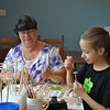 Melanie Sherwood and daughter Rachel decorated Kindness Coins during the grand opening of Ben's Bells Newtown studio, Saturday, July 13. The Church Hill Road studio is the first for the program outside its home base in Tuscon, Ariz., and it will offer twice-weekly workshops for anyone who would like to visit and help spread kindness one act at a time.  (Crevier photo)