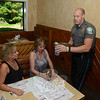 Social Services Administrative Assistant Ann Benore, seated left, and Assistant Town Clerk Monica Duhancik stopped for an early dinner at Newtown Pizza Palace on Wednesday, July 17. Officer William Chapman waited on their table this week during the Tip-A-Cop night. All tips officers earned Wednesday will benefit the Connecticut Special Olympics.