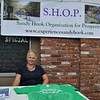 "Sandy Hook Organization for Prosperity (SHOP) hosted a special ""Peace, Love & Sandy Hook"" event, Saturday, July 13. Among those participating in the event was Sharon Doherty, the owner of PJ's Laudrymat. Mrs Doherty had a table set up on the sidewalk in front of Sandy Hook Deli & Catering, where she was selling Experience Sandy Hook T-shirts. (Crevier photo)"