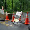 Cement blocks, traffic cones, and multiple warning signs across Dickinson Drive bar the curious from gaining access to Sandy Hook Elementary School. (Crevier photo)
