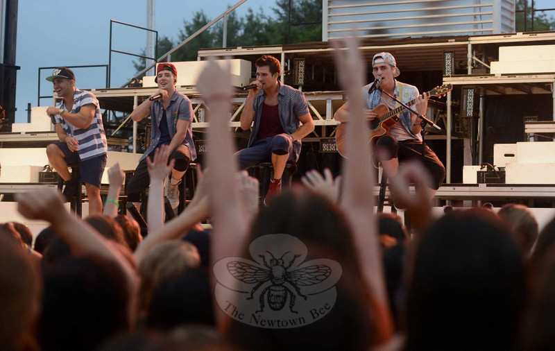 "Big Time Rush made a special appearance in Newtown on Monday, July 22, performing for a few thousand fans on a night off from their Summer Break Tour 2013. The popular television stars and performers — from left,  Carlos Pena, Jr, Logan Henderson, James Maslow, and Kendall Schmidt — said on Monday they were ready, willing, and anxious to help wipe away some of the sadness, fear, anxiety, or grief the community has faced since 12/14, if only for an hour. The concert was one of the final events being organized with the Town of Newtown, and rain could not dampen the spirits of those who attended.   (Bobowick photo)<br /> <br /> PLEASE NOTE: Additional photos from this event, which were presented online in a slideshow, can be viewed here:<br /> <a href=""http://photos.newtownbee.com/Journalism/Special-Events/Big-Time-Rush-concert-for"">http://photos.newtownbee.com/Journalism/Special-Events/Big-Time-Rush-concert-for</a>"