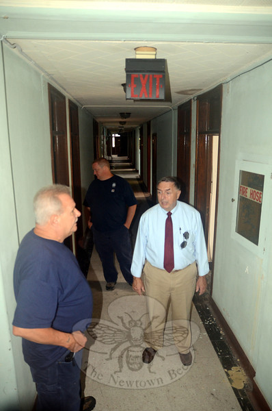 Inside Danbury Hall, Public Works Director Fred Hurley, right, and town workers Dave Ferraro, left, and Pete Daccolti marvel at the quality of the woodwork still evident throughout the 1930s-era building. (Voket photo)