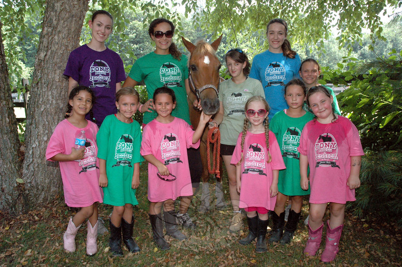 Staff and students at Jessica's Camp, a horse training scholarship program, posed for a group photo at the camp at Kings Bridge Farm on July 19. Rear row from left, are counselor Kelly Coughlin, instructor Montana Calloway, the Welsh pony known as Waffles, and counselors Michele Reid, Jess Coughlin and Daly King. The six girls in the front row were the first students to participate in the program. (Gorosko photo)