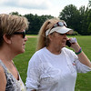 "Great Newtown Reunion organizers Sharon Dest Pacenka, left, and Wendy Lee Hewitt were busy on Wednesday, overseeing the installation of the tent for Saturday's main event. The volunteers say that anyone interested in purchasing any of the remaining tickets must do so by midnight Friday, July 26. Tickets will not be sold at the event. Visit  <a href=""http://www.GreatNewtownReunion.org"">http://www.GreatNewtownReunion.org</a> or find the event's page on Facebook for details and additional information. (Voket photo)"