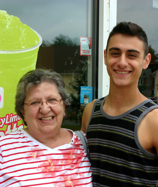 Newtown Bee: What do you like to do on a rainy summer day? Rose Meli, left, and grandson Michael Gregorio: Watch TV and drink Dunkin' Donuts. (Francke photo)