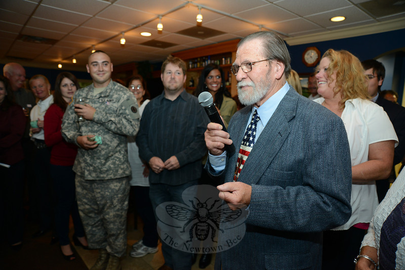 Artist David Merrill addresses the crowd Saturday during the Project Newtown Troops and Veterans fundraiser. He is completing a mural for this project to recognize Newtown's veterans.   (Bobowick photo)