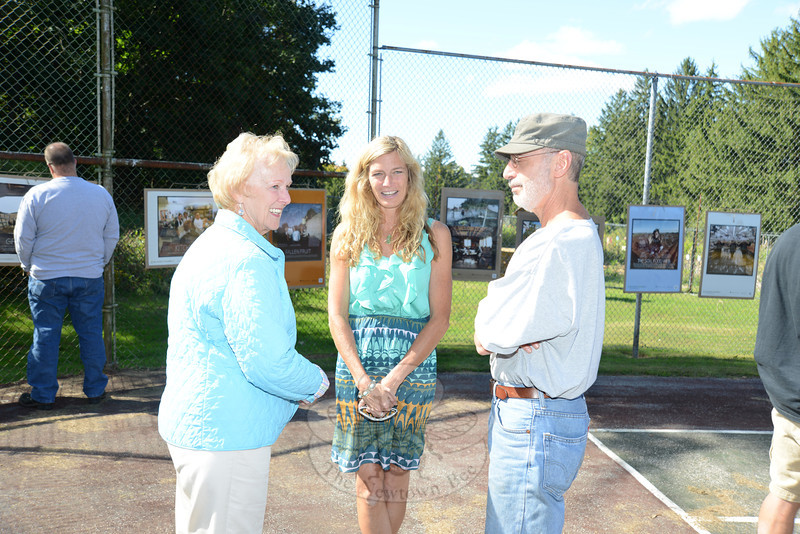 First Selectman Pat Llodra, left, talks with Parks and Recreation Director Amy Mangold and Parks and Recreation Commission member Richard Boritz during the second annual Victory Garden Harvest Festival.   (Bobowick photo)
