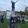 More than 20 Newtown High School cheerleaders attended the Light The Night event on September 29. Besides terrestrial activity, the cheerleaders performed various aerial stunts involving members being tossed into the air and landing unharmed.   (Gorosko photo)