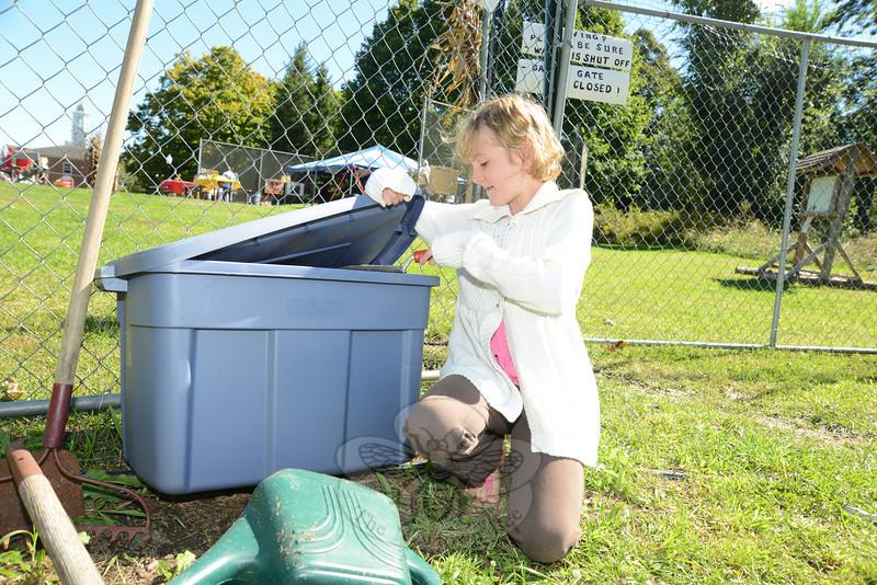 Mackenzie Hughes puts away her gardening tools for the season.   (Bobowick photo)