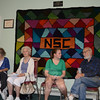 It was a multi-generational experience for Amanda Tramposch, second from right, who attended the recent open house at Newtown's Senior Center, as she chats with Edward Rees. She was joined by Eileen Willig (with purse) and Jean Reilly.   (Voket photo)