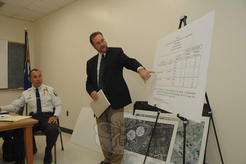 As Police Captain Joe Rios, left, looks on at an October 2 Police Commission meeting, traffic engineer Michael Galante explains the projected traffic flow for an office and storage complex proposed for 90 Mt Pleasant Road (State Route 25/US Route 6). The Police Commission, serving as the traffic authority, endorsed the project's traffic plans.   (Gorosko photo)