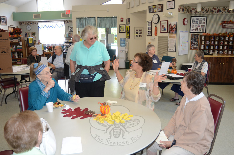 From left, Glenna Rees, Vicki Bocuzzi, Commission on Aging Vice Chair Sheila Torres, and Dorothy Thompson chat in the Newtown Senior Center main room during an open house event September 15.   (Voket photo)