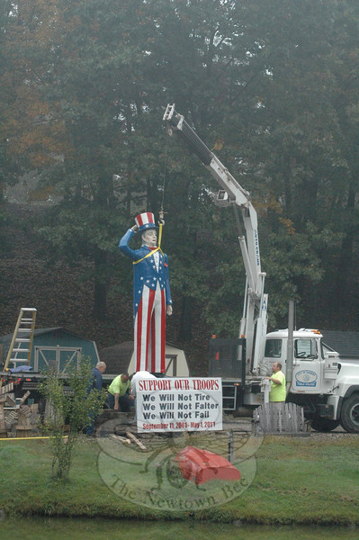 On the morning of Thursday, October 4, members of a City of Danbury public utilities work crew carefully prepared a 13-foot tall statue of Uncle Sam for shipment from Newtown Mulch & Outdoor in Hawleyville to Danbury, where the statue will be displayed in the main lobby at Danbury City Hall. The statue originally was displayed at the Danbury Fair.   (Gorosko photo)