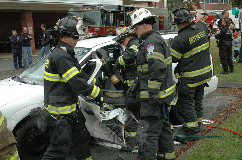 In a simulation, members of Botsford Fire Rescue Company demonstrated the techniques used to disassemble a motor vehicle, when required for the extrication of trapped occupants following serious accidents.   (Gorosko photo)