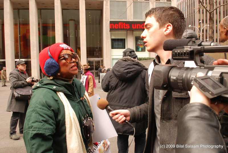 Reverend Kennedy, long time activist,  is interviewed by the media.