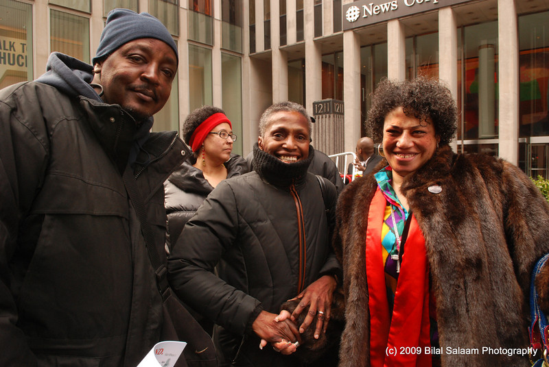 Viola Plummer, surrounded by supporters at protest rally.