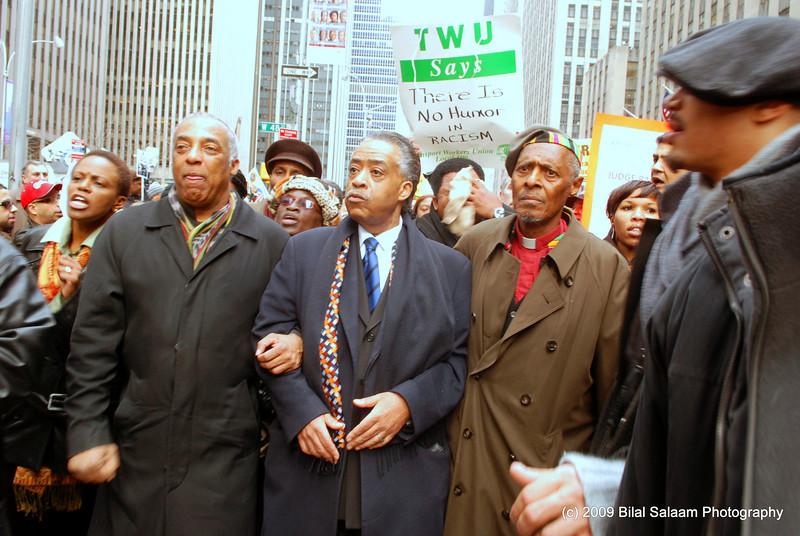 City Councilman Charles Barron, Al Sharpton and activist, Rev. Daughtry lead protestors.