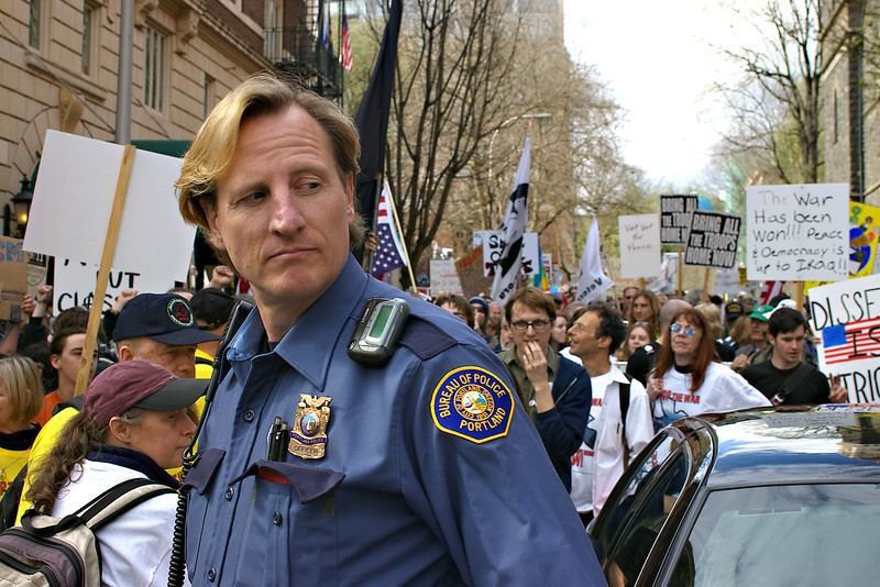 Police officer watches the crowd.<br /> Portland, Oregon <br /> 2007