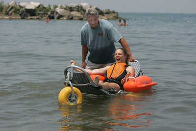 29JUN12   Samantha Taylor checks out the special beach equipment --the Mobi Chair--a type of amphibious beach wheelchair--that's available at Lakeview Park.         Photo  by Chuck Humel