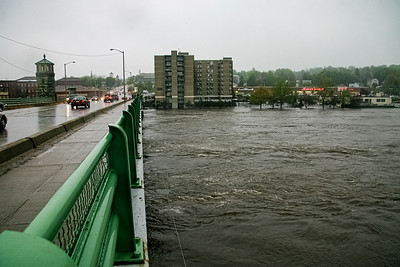 The Merrimack River overflows its banks underneath the Basiliere Bridge on Main St. in Haverhill, MA.