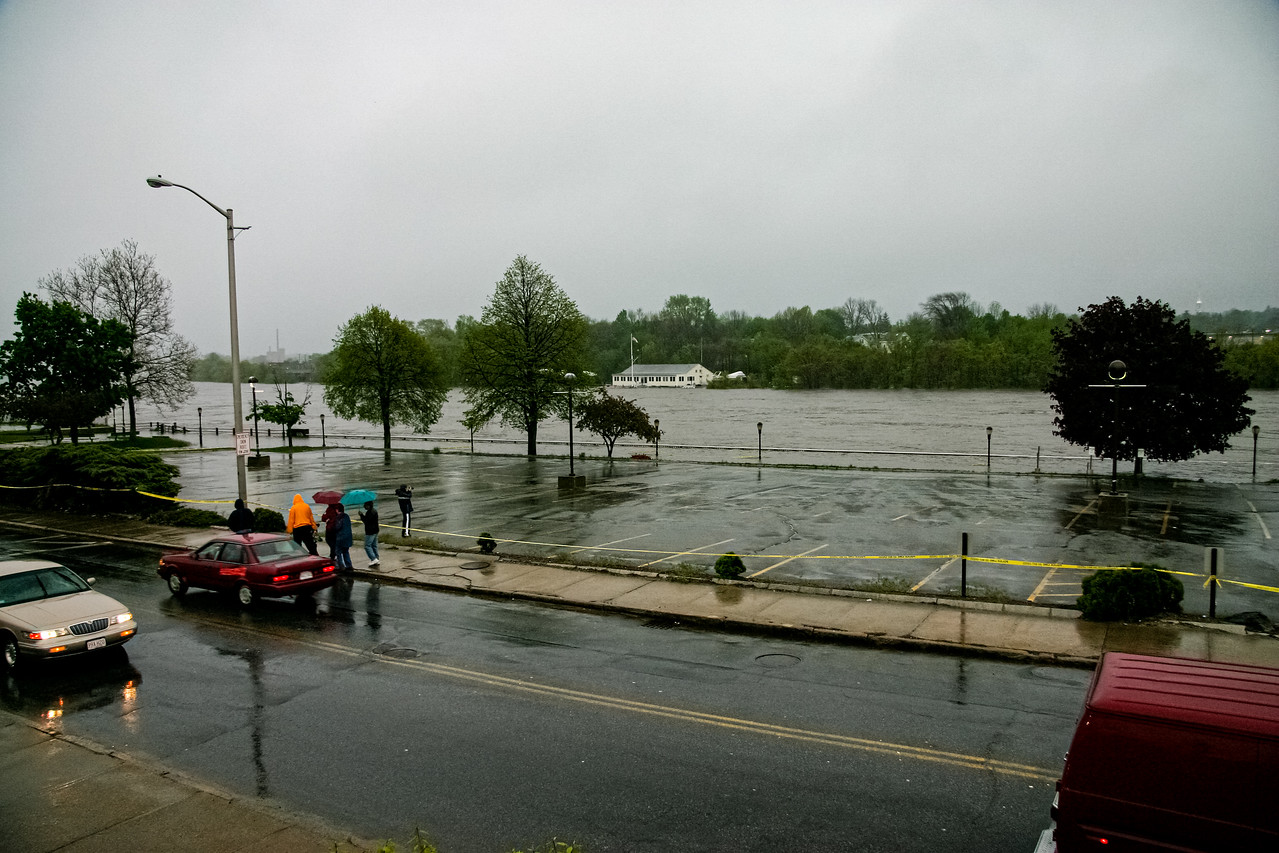 The Merrimack River overflows its banks on River St. in Haverhill, MA.