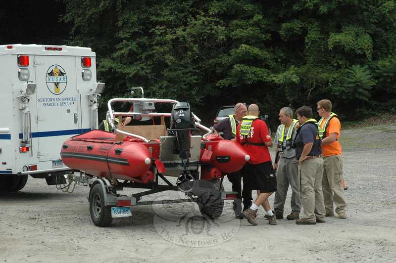 Members of Newtown Underwater Search And Rescue (NUSAR) responded to the town-owned Eichler's Cove boat launch on the Lake Zoar section of the Housatonic River on the afternoon of Tuesday, August 14, after receiving a 1:33 pm report from the Coast Guard that there might be a boat-in-distress/possible drowning incident on Lake Zoar based on a distress call that it had received. Emergency officials also employed a low-flying helicopter in search-ing for the problem. NUSAR did not put its boat into the water at Eichler's Cove after learn-ing that the incident either had occurred elsewhere on the river or was unfounded. Sandy Hook volunteer firefighters and town police also responded. Emergency  services staffers from other towns along the river also participated in the search. (Gorosko photo)