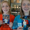 From left, Newtowners Diana Kirkman, 12, and her sister, Victoria, age 14, each hold pictures of themselves at age 5 — after each make her first donation of hair to create wigs for cancer patients. To date, between them the two sisters have already donated about 110-inches of hair and both plan to continue the practice into the foreseeable future.  (Voket photo)