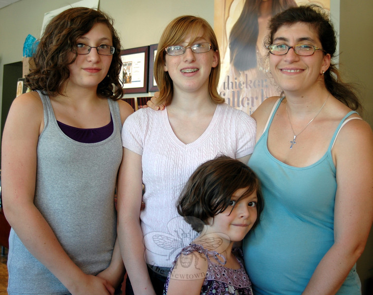 From left, sisters Dylana Coperine, Anneliese, and Grace Hermes stand with their mom Kirsten Hermes at A New Beginning, an Aveda Wellness Salon and Day Spa in Stony Hill. The three sisters, ages 17, 13, and 7, have each donated a length of hair following their mother's cancer treatments, and now that she is recovered, Kirsten has begun donating hair to the Beautiful Lengths program as well. (Voket photo)