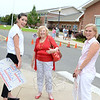 Former town clerk and state lawmaker Mae Schmidle is flanked outside the Reed Interme-diate School primary polls by Christopher Shays campaign volunteer Gretchen Hahn, left, and local Democrat Lisa Romano. Both Ms Romano and her 106th District GOP challenger Mitch Bolinsky were campaigning at the primary polls Tuesday, and stayed afterward to monitor the local returns. (Bobowick photo)